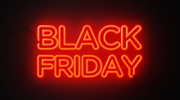 Black Friday Red Neon Light On Black Wall - Black Friday Concept Black Friday red neon light on black wall. Horizontal composition with copy space. Black Friday concept. black friday sale neon stock pictures, royalty-free photos & images