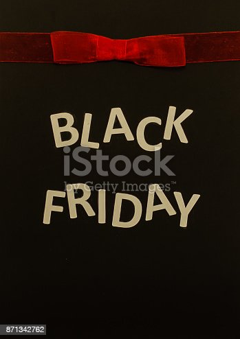 istock Black friday sale banner with red bow 871342762