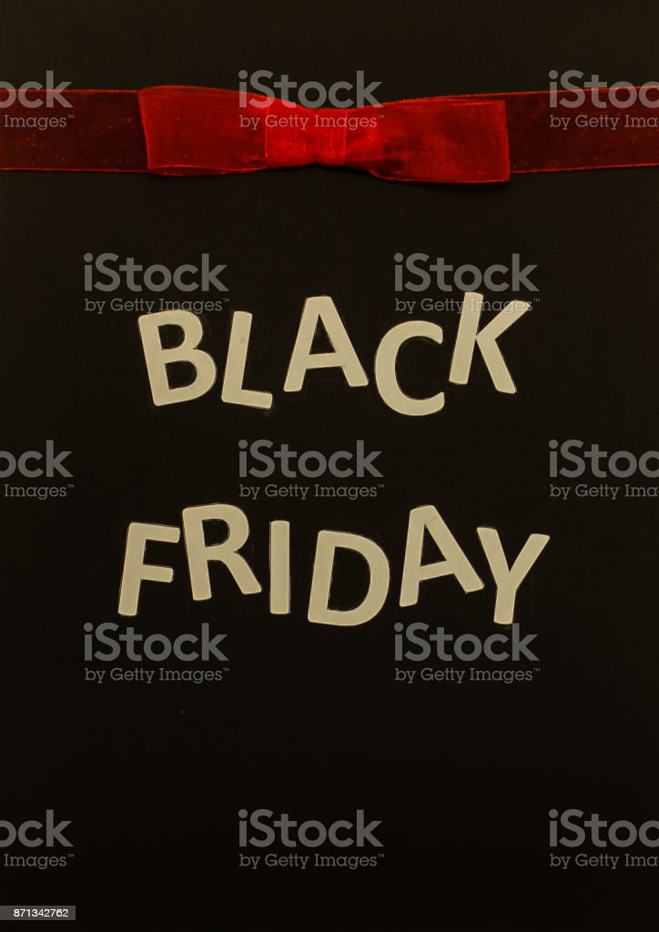 Black friday sale banner with red bow stock photo