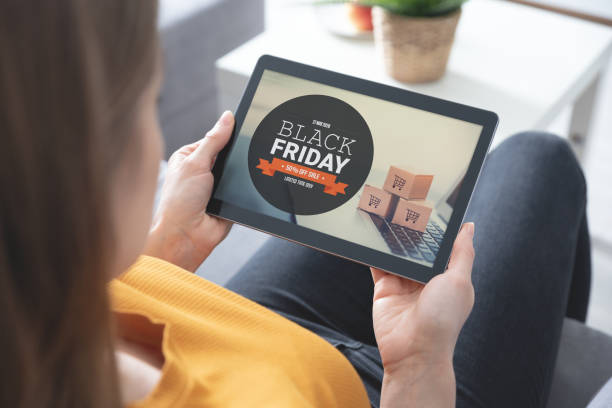Black Friday sale. Big sale, woman with tablet stock photo