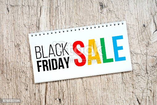 istock black friday sale, black and colorful text in notepad on white rustic table 876530194