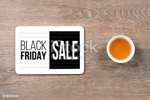 istock black friday sale, black and white text in digital tablet on office table 876530344