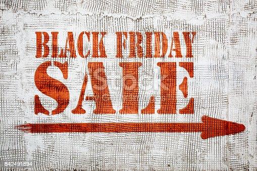 istock Black Friday sale graffiti on stucco wall 842491894