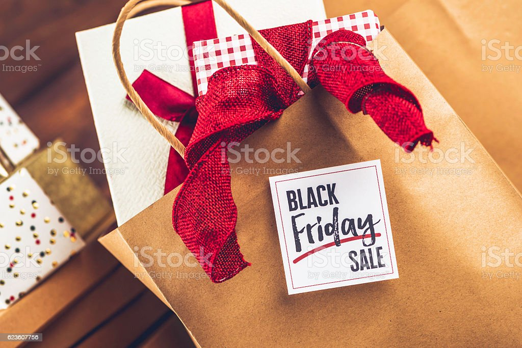 Black Friday Sale shopping bag, gifts and message stock photo