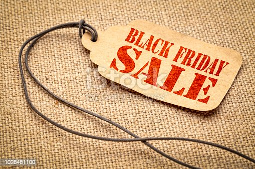 istock Black Friday sale sign on paper price tag 1028481100