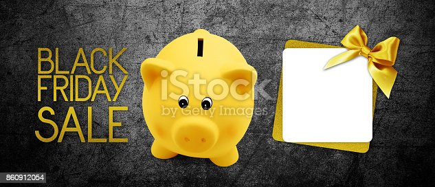 670414478 istock photo Black Friday sale text gift card and piggy bank with golden ribbon bow on black background 860912054