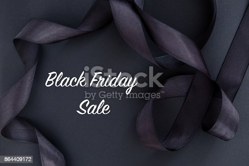 istock Black Friday sale text with black ribbon 864409172