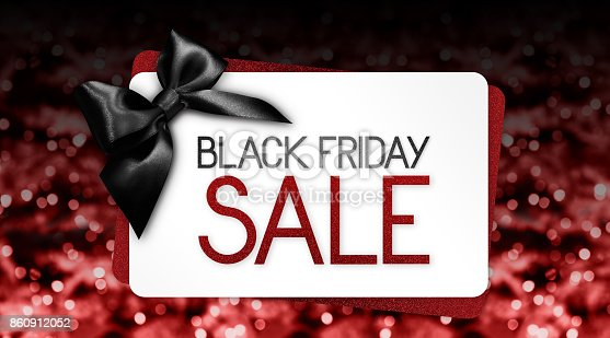 670414478 istock photo Black Friday sale text write on gift card label with black ribbon bow on red blurred bright lights background 860912052