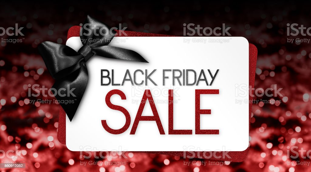 Black Friday sale text write on gift card label with black ribbon bow on red blurred bright lights background stock photo