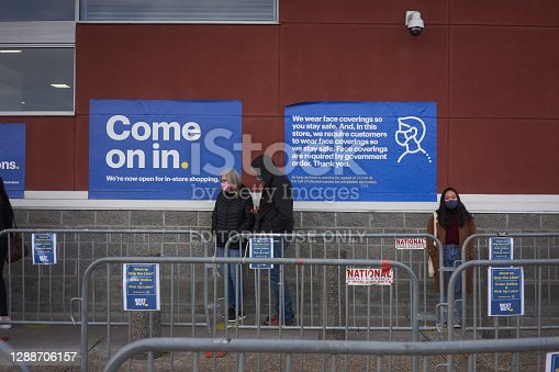Beaverton, OR, USA - Nov 27, 2020: Masked shoppers line up outside a Best Buy store in Beaverton, Oregon, on Black Friday amid the coronavirus pandemic.