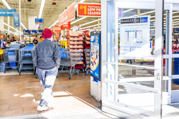 black friday sign in walmart store entrance with map after thanksgiving shopping consumerism in virginia with sikh man walking inside - walmart zdjęcia i obrazy z banku zdjęć