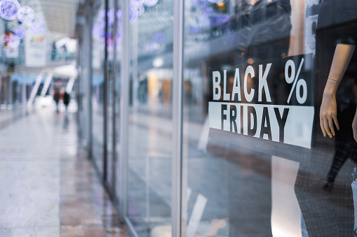 black friday sign on store display background in a mall during christmas holidays .