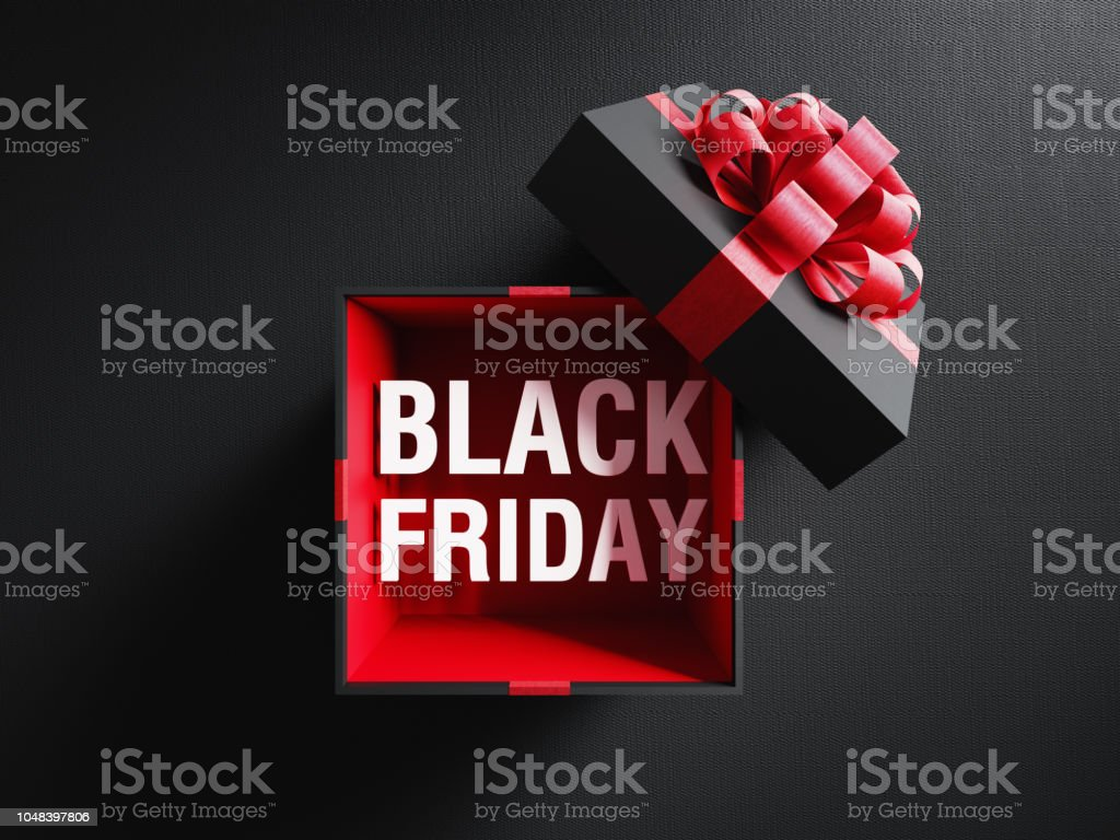 Black Friday Text Coming Out Of A Black Gift Box Tied With Red Ribbon stock photo