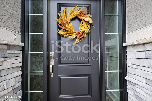 istock Black Front Door Autumn Wreath 1141331975