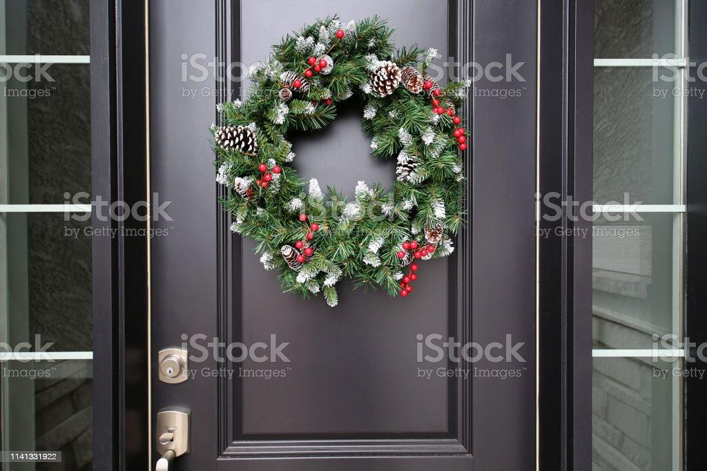 Black Front Door Green Christmas Wreath up close