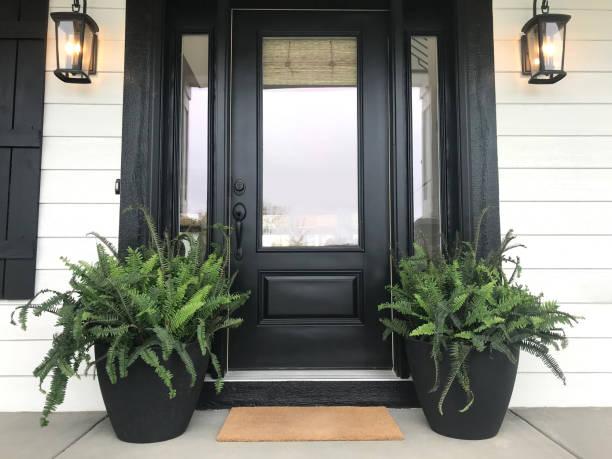 Black Front Door with Plants front door with plants front door stock pictures, royalty-free photos & images