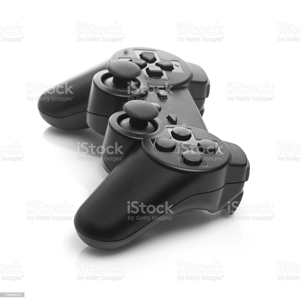 Black game controller against a white background royalty-free stock photo