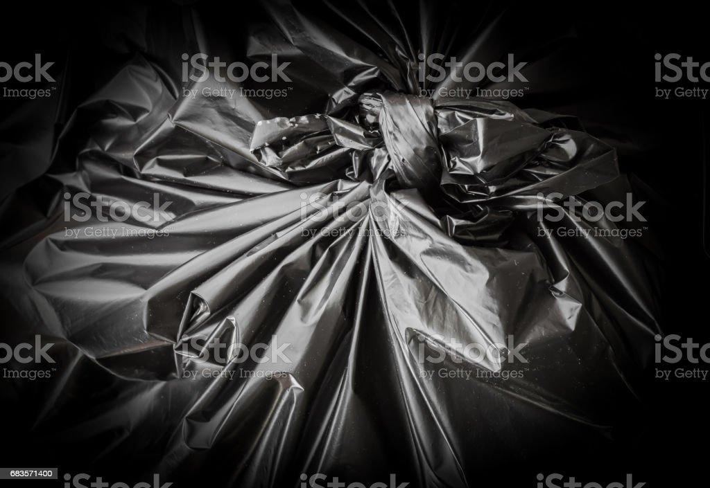 Black garbage bag stock photo