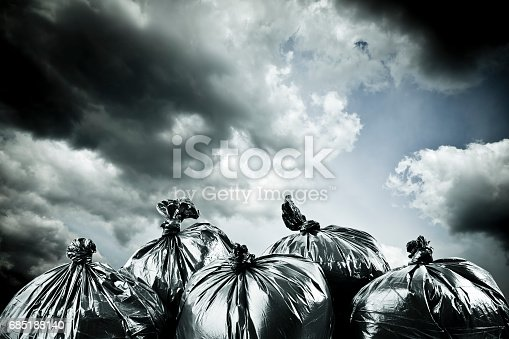 istock Black garbage bags and stormy sky outside. Apocalypse and pollution concept. 685188140