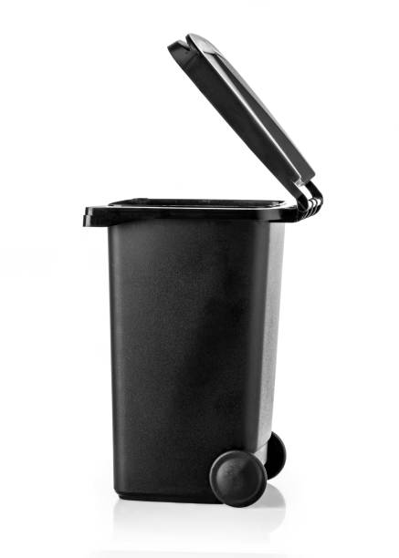 Black garbage bin on the white stock photo