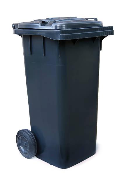 Black garbage bin on white background stock photo