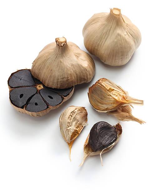 black garlic bulbs and cloves