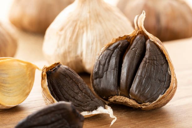 Black garlic, garlic fermented healthy food Black garlic, garlic fermented healthy food fermented garlic stock pictures, royalty-free photos & images