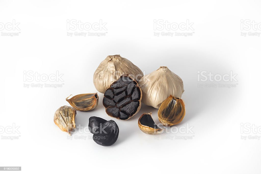 Black garlic grouped on white background stock photo