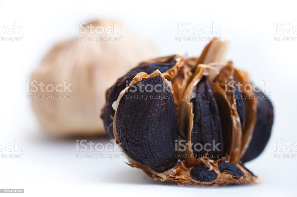 Black Garlic on white backgroud stock photo