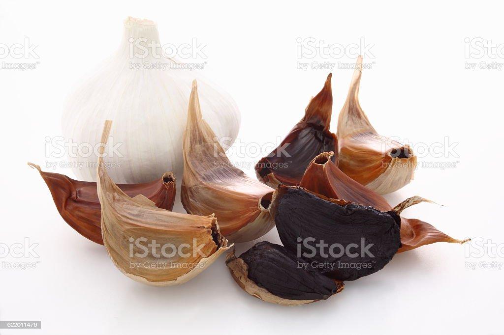 Black garlic with raw garlic stock photo