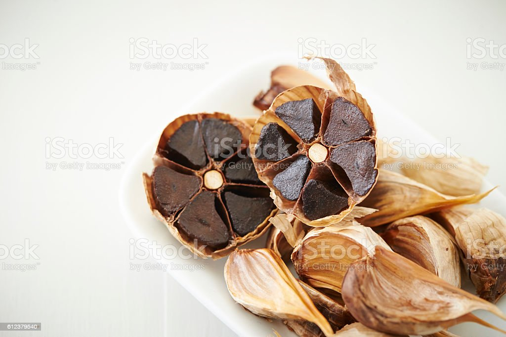 Black garlics stock photo