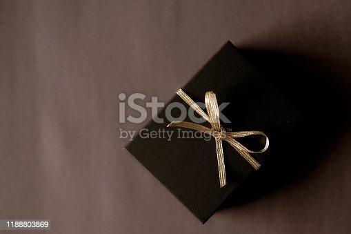 istock Black gift box dark background. 1188803869