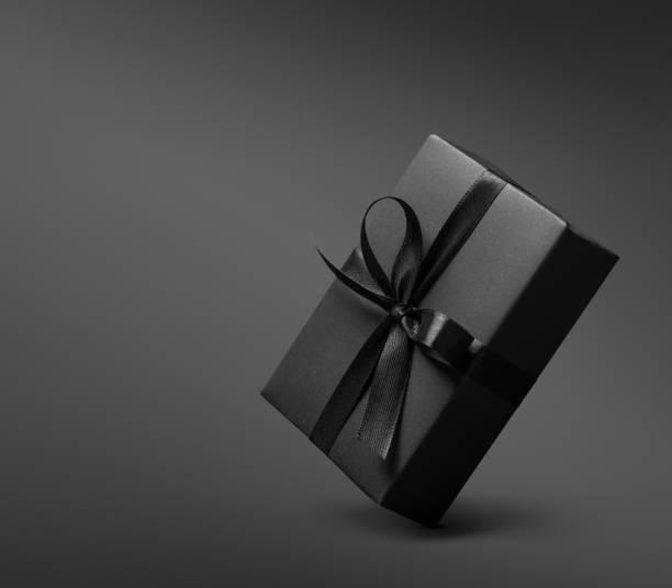 Black Gift box on dark background stock photo