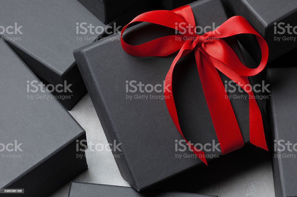 Black gift box with a big red ribbon royalty-free stock photo