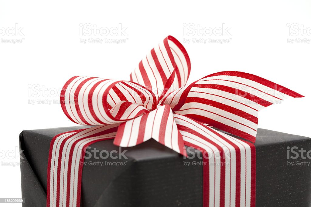 black gift box with striped bow stock photo