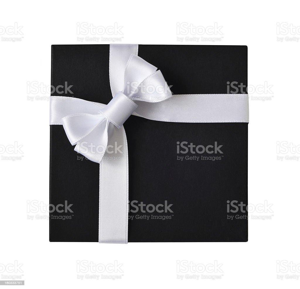 Black gift box with white ribbon stock photo
