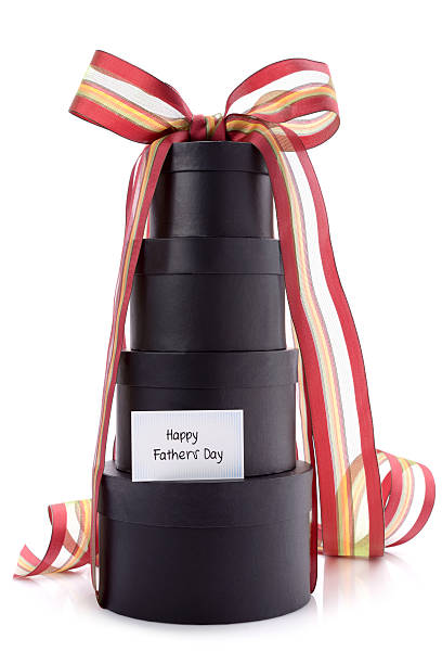 Black gift boxes on white with fathers day card stock photo
