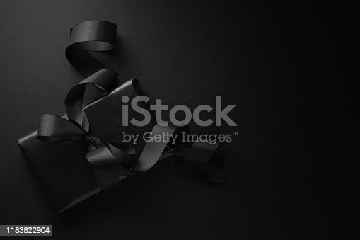 istock Black gift on dark background 1183822904