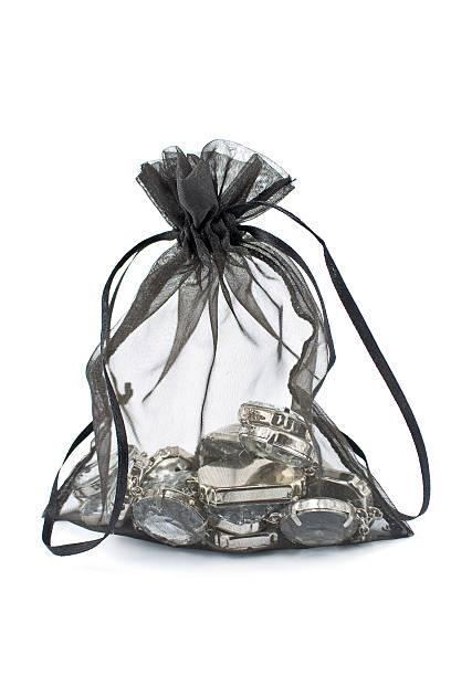 Black gift sack with diamonds isolated on white stock photo