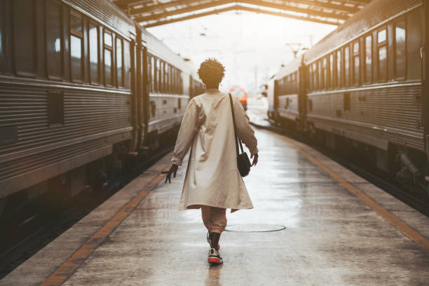 Black girl between two trains stock photo
