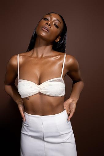 black girl on brown back drop