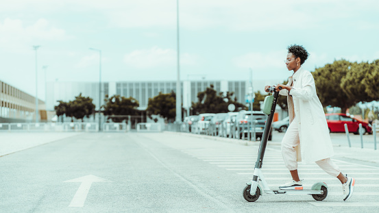 istock Black girl on e-scooter outdoors 1182441500