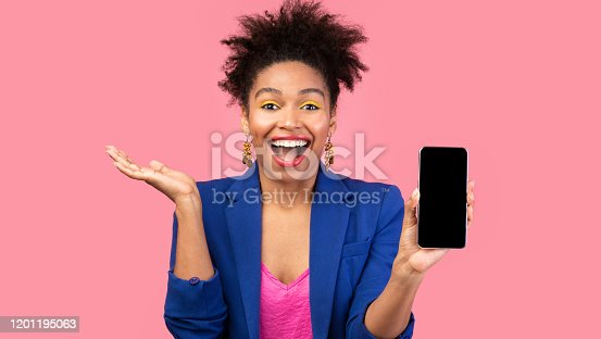 1084491176 istock photo Black girl showing blank cell phone screen 1201195063