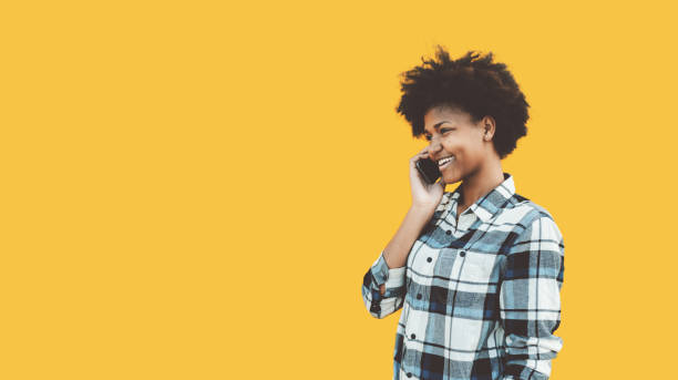 Black girl talking on the phone stock photo