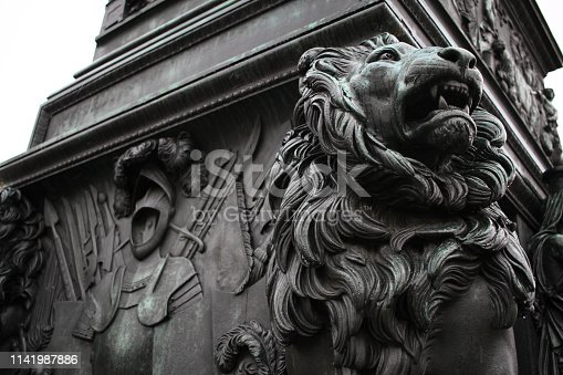 Black glossy metal strong teeth scary hairy Lions statue, attractive sculpture art, travel destination backgrounds