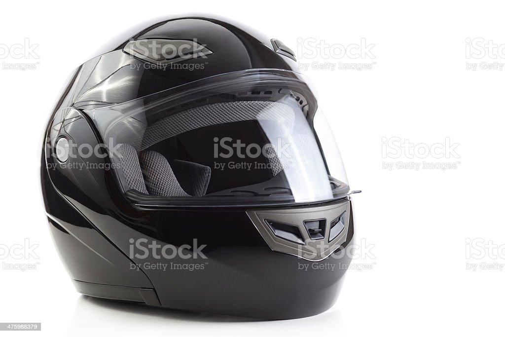 Black, glossy motorcycle helmet stock photo