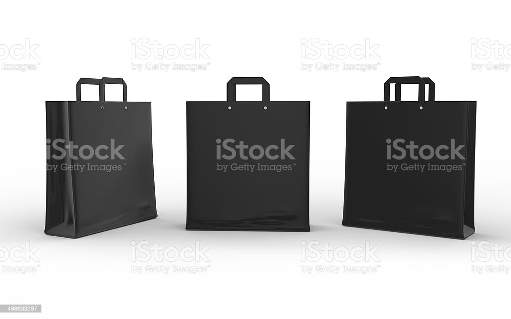 Black glossy paper bag isolated on white with clipping path stock photo