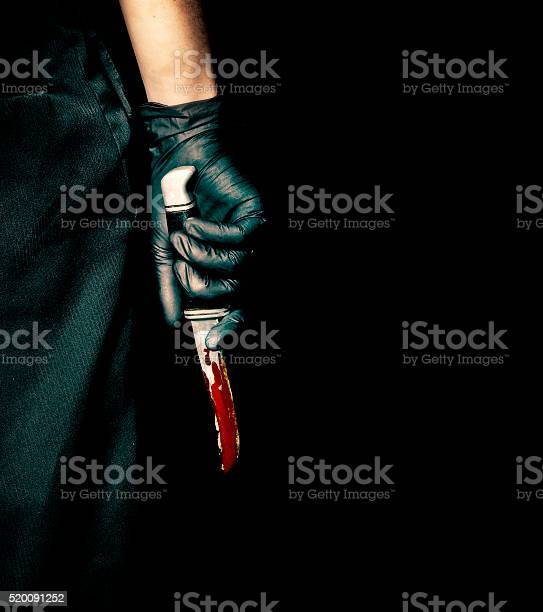 Black Glove And Bloody Knife Stock Photo - Download Image Now