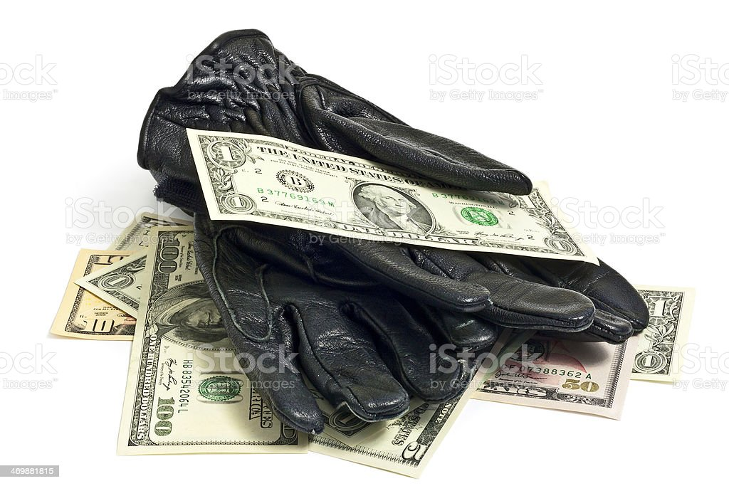 Black gloves and dollar bills stock photo