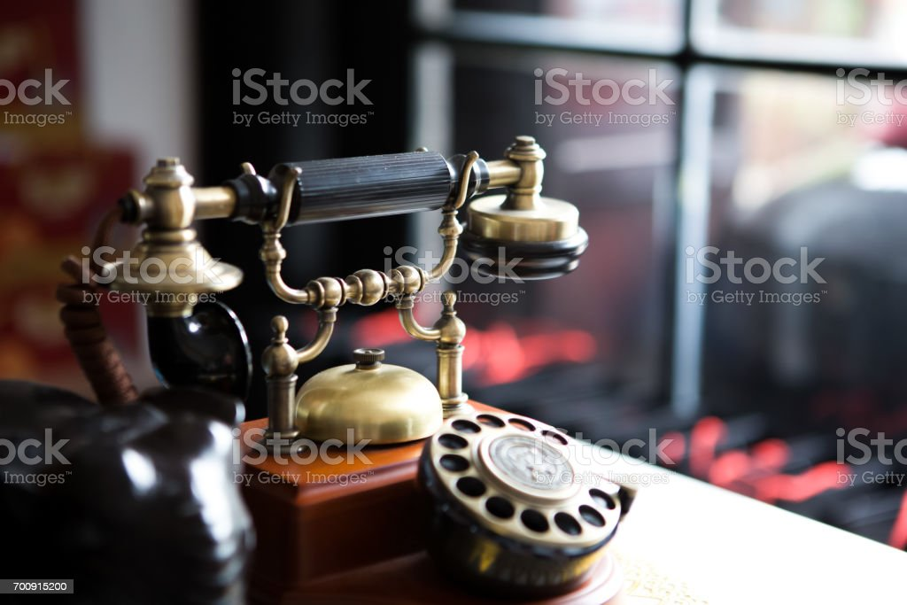 Black gold antique vitage telephone, abstract of communication stock photo